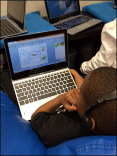 Student working on Wixie project on the sounds of the letter i